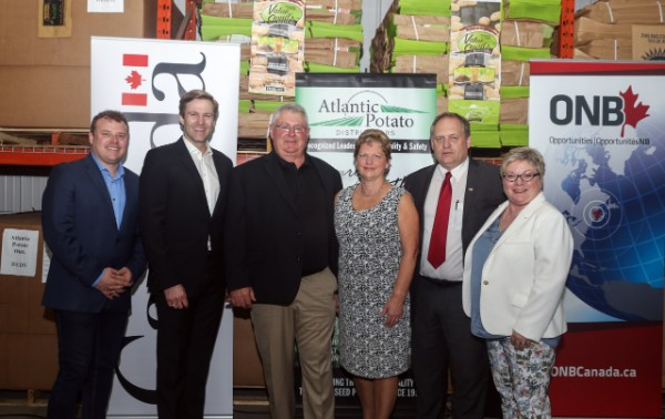 From left: Tobique-Mactaquac MP T.J. Harvey; Premier Brian Gallant; Ralph and Nancy Hanscome, founders of Atlantic Potato Distributors; Carleton-Victoria MLA Andrew Harvey; and Economic Development Minister Francine Landry, who is also minister responsible for Opportunities NB.
